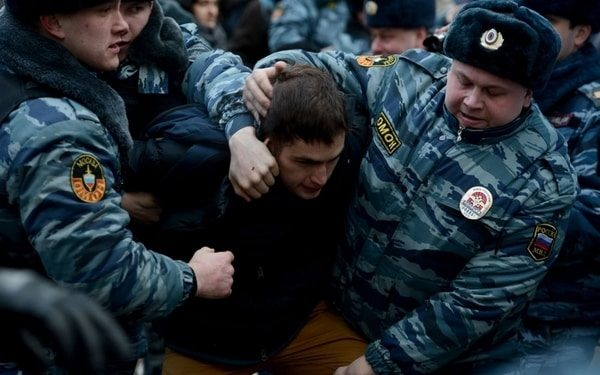 demonstration in Russia policemen-handle activists during a protest